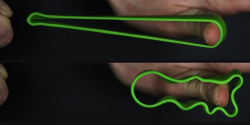Focus: <i>Video</i>—Slow-Motion Footage Captures Rubber Band Ripples