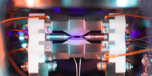 Fewer Lasers Achieve Higher Fidelity Logic Gate